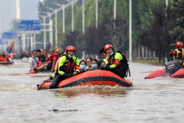 The death toll from floods in central China rose to 302 after torrential downpours dumped a year's rain on a city in just three days last month.