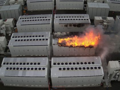 This handout picture taken on July 30, 2021 and released on August 2 by Fire Rescue Victoria shows a fire from a 13-tonne lithium battery unit at a Tesla battery site in Australia