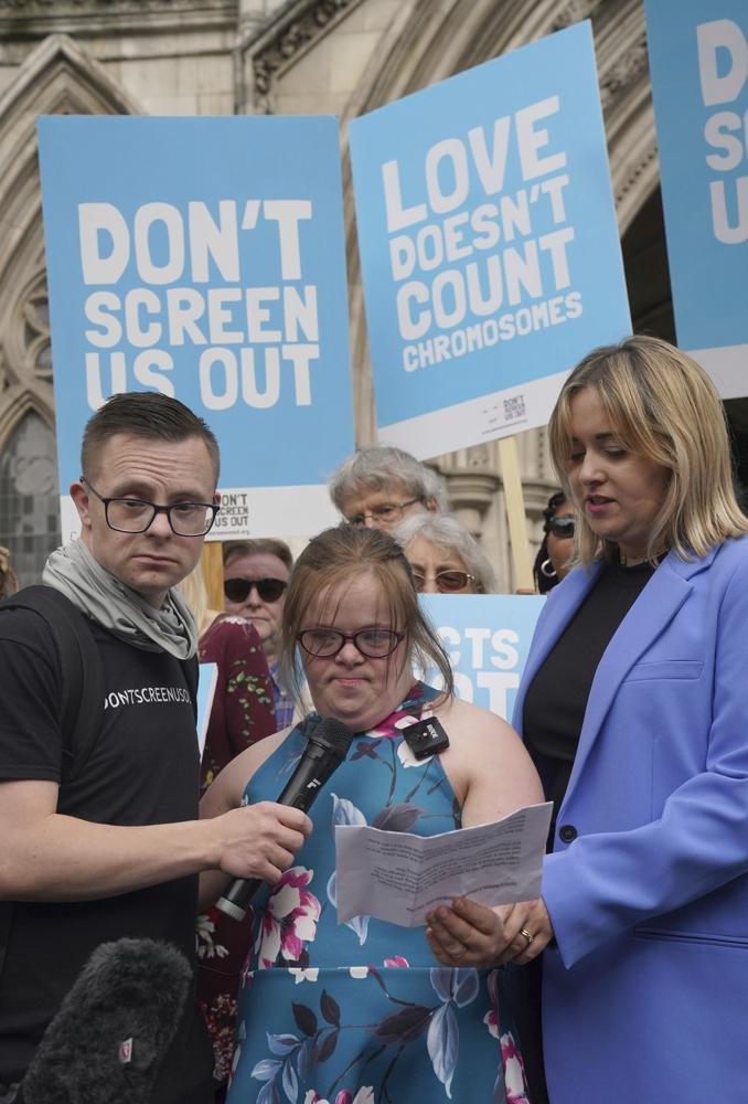 """Campaigner Heidi Crowter speaks after her court case outside the High Court in London, Thursday, Sept. 23, 2021. A woman with Down's syndrome has lost a court challenge against the British government over a law allowing the abortion up until birth of a foetus with the condition. Heidi Crowter, 26, and two others argued that part of the Abortion Act is discriminatory. Abortions in England, Wales and Scotland are allowed up till 24 weeks of pregnancy, but terminations can be allowed up until birth if there is """"a substantial risk"""" that if the child were born it would suffer from serious abnormalities. (Gareth Fuller/PA via AP)"""