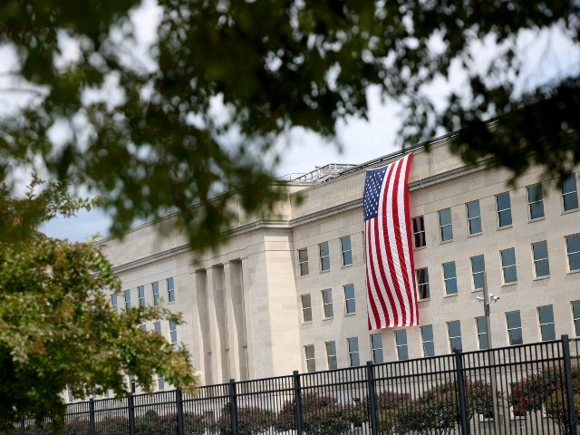 ARLINGTON, VIRGINIA - SEPTEMBER 11: A flag hangs outside of the Pentagon prior to wreath laying ceremony with President Joe Biden, First Lady Jill Biden, Vice President Kamala Harris and Second Gentleman Doug Emhoff scheduled to take place later this afternoon at the National 9/11 Pentagon Memorial on September 11, …