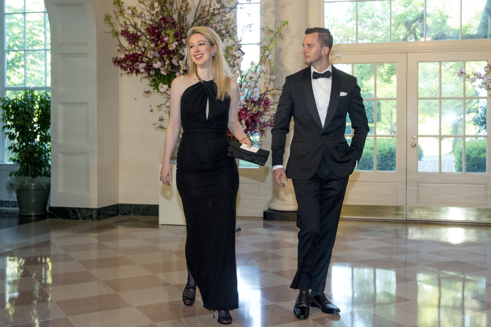 Theranos Inc. Founder and CEO Elizabeth Holmes, left, and Christian Holmes arrive for a state dinner for Japanese Prime Minister Shinzo Abe, Tuesday, April 28, 2015, at the White House in Washington. (AP Photo/Andrew Harnik)