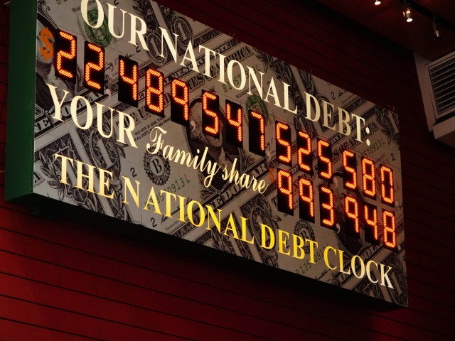 Photo by: John Nacion/STAR MAX/IPx 2020 5/9/20 A view of The National Debt Clock in Times Square in New York City USA during the coronavirus pandemic on May 9, 2020 in New York City. COVID-19 has spread to most countries around the world, claiming over 270,000 lives with over 3.9 …