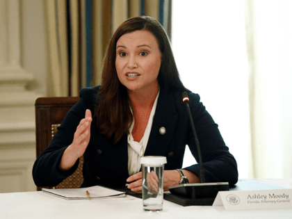 In this June 8, 2020, file photo, Florida Attorney General Ashley Moody speaks during a roundtable discussion at the White House in Washington. On Wednesday, July 21, 2021, Moody tweeted that she has tested positive for COVID-19. Moody said she had been vaccinated for the virus earlier in the year. …