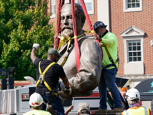 Crews remove the torso of Confederate General Robert E. Lee, one of the country's largest remaining monuments to the Confederacy, on Monument Avenue in Richmond, Va., Wednesday, Sept. 8, 2021. (AP Photo/Steve Helber)