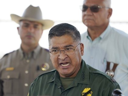 Border Patrol Chief Raul L. Ortiz speaks to the media near the International Bridge where thousands of Haitian migrants have formed a makeshift camp, Sunday, Sept. 19, 2021, in Del Rio, Texas. Ortiz said that 3,300 migrants have already been removed from the Del Rio camp to planes or detention …