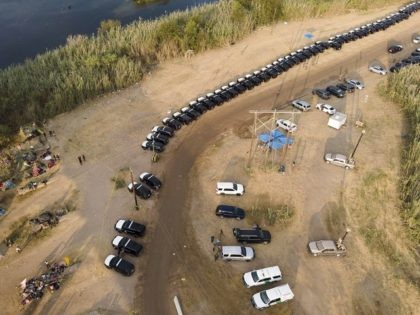 Texas Department of Safety vehicles line up along the bank of the Rio Grande near an encampment of migrants, many from Haiti, near the Del Rio International Bridge, Tuesday, Sept. 21, 2021, in Del Rio, Texas. The U.S. is flying Haitians camped in a Texas border town back to their …