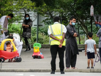 MANCHESTER, ENGLAND - AUGUST 25: People believed to have recently arrived from Afghanistan stand in the courtyard of a hotel near Manchester Airport on August 25, 2021 in Manchester, England. The British government recently announced that it planned to transport thousands of Afghans to the UK as part of its …