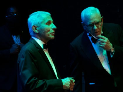National Institute of Allergy and Infectious Diseases Director Anthony Fauci (L) speaks with US businessman David Rubenstein during the 43rd Annual Kennedy Center Honors press conference at The Kennedy Center on May 21, 2021 in Washington, DC. (Photo by ANDREW CABALLERO-REYNOLDS / AFP) (Photo by ANDREW CABALLERO-REYNOLDS/AFP via Getty Images)