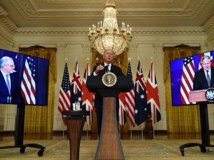 US President Joe Biden participates is a virtual press conference on national security with British Prime Minister Boris Johnson (R) and Australian Prime Minister Scott Morrison in the East Room of the White House in Washington, DC, on September 15, 2021. (Photo by Brendan Smialowski / AFP) (Photo by BRENDAN …