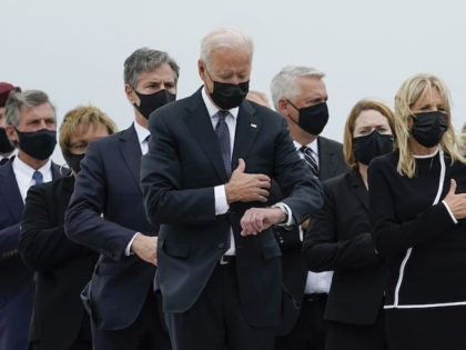 President Joe Biden, first lady Jill Biden and others attend a casualty return as a carry team finishes placing a transfer case containing the remains of Marine Corps Lance Cpl. Jared M. Schmitz, 20, of St. Charles, Mo., into the transfer vehicle Sunday, Aug. 29, 2021, at Dover Air Force …