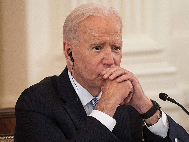US President Joe Biden listens as India Prime Minister Narendra Modi speaks with Japan Prime Minister Suga Yoshihide and Australian Primer Minister Scott Morrison during the first-ever in-person Quad Leaders Summit in the East Room of the White House in Washington, DC, on September 24, 2021. (Photo by Jim WATSON …