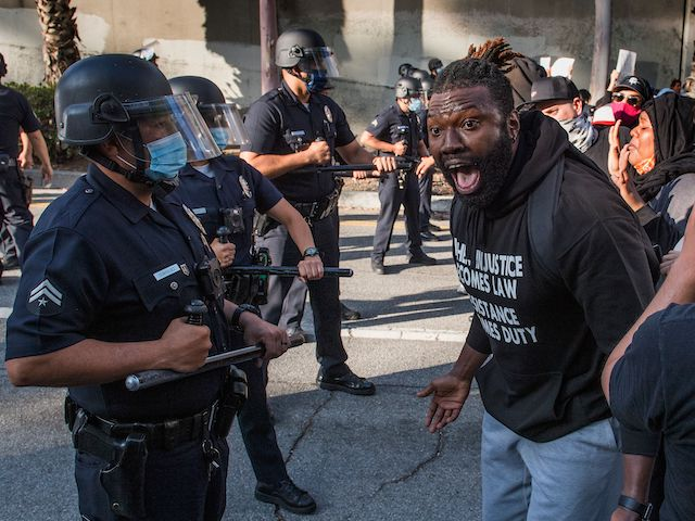 A demonstrator confronts police as he protests the death of George Floyd, in Los Angeles, California on May 29, 2020. (Mark Ralston/AFP via Getty Images)