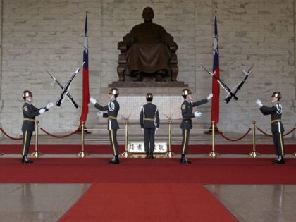 Taiwan's military honor guard march in front of a statue of Chiang Kai-shek at a massive memorial dedicated to the late Chinese Nationalist Party (KMT) leader, Wednesday, Feb. 7, 2007, in Taipei, Taiwan. In an effort to boost Taiwan's identity, the ruling Democratic Progressive Party, DPP, has asked all military …