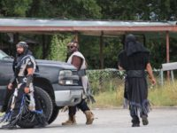 Black 'Extremist' Group Appears at Texas Border Bridge Camp with Food for Migrants