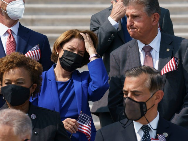 Sen. Amy Klobuchar, D-Minn., left, and Sen. Joe Manchin, D-W.Va., stand on the steps of the Capitol during a Sept. 11 remembrance ceremony, in Washington, Monday, Sept. 13, 2021. As congressional Democrats speed ahead this week in pursuit of President Joe Biden's $3.5 trillion plan for social and environmental spending, …