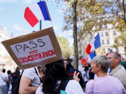 Medical staff members demonstrate against the compulsory Covid-19 vaccination for certain workers, and the mandatory use of the health pass called by the French government to access most public spaces, in front of the Health Ministry in Paris on September 11, 2021. - France began enforcing on August 9, 2021, …