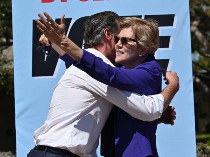 Gavin Newsom and Elizabeth Warren (Robyn Beck / AFP / Getty)