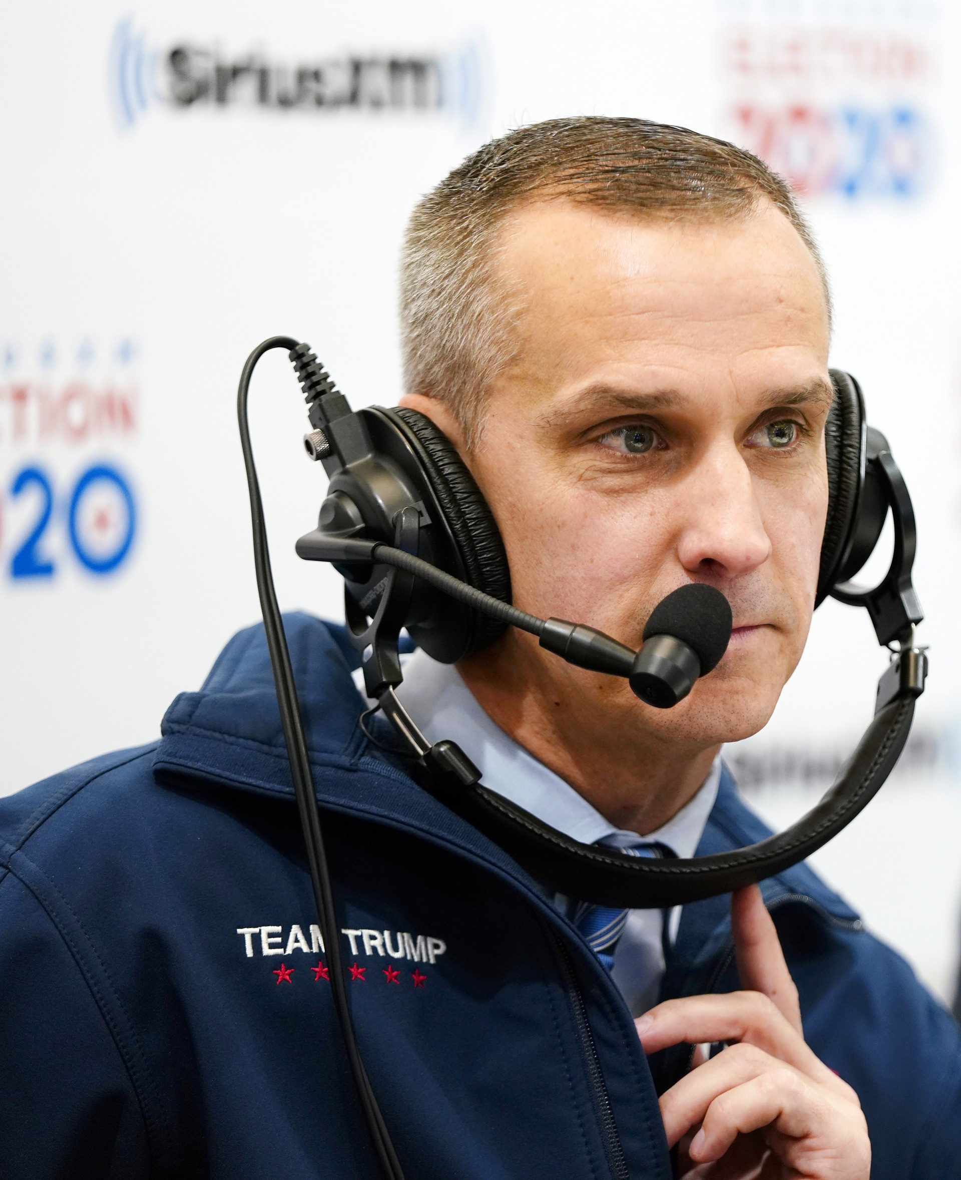 Senior adviser to Trump 2020, Corey Lewandowski looks on while talking with Sirius XM P.O.T.U.S host Tim Farley and David Bossie in the Coolidge Room at the DoubleTree by Hilton on February 11, 2020 in Manchester, New Hampshire. (Photo by Omar Rawlings/Getty Images for SiriusXM)