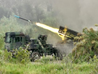 """A projectile is launched from a Taiwanese-made Thunderbolt-2000 multiple rocket system during the annual Han Kuang military drills in Taichung on July 16, 2020. - The five-day """"Han Kuang"""" (Han Glory) military drills starting on July 14 aimed to test how the armed forces would repel an invasion from China, …"""