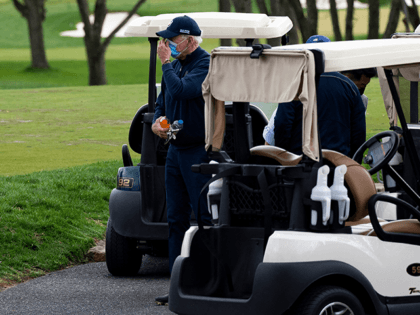 US President Joe Biden leaves his cart after a round of golf at Wilmington Country Club in Wilmington, Delaware, on April 17, 2021. - President Joe Biden played golf for the first time in his presidency Saturday, hitting the fairways in his home city of Wilmington. (Photo by JIM WATSON …