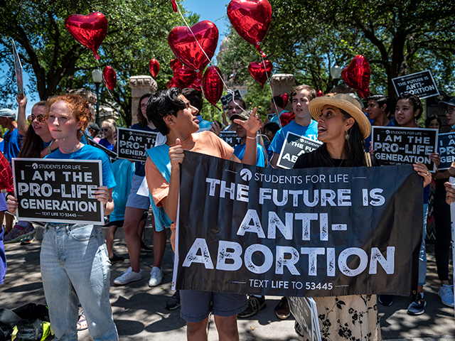 Pro-life protesters stand near the gate of the Texas state capitol at a protest outside the Texas state capitol on May 29, 2021 in Austin, Texas. Thousands of protesters came out in response to a new bill outlawing abortions after a fetal heartbeat is detected signed on Wednesday by Texas …