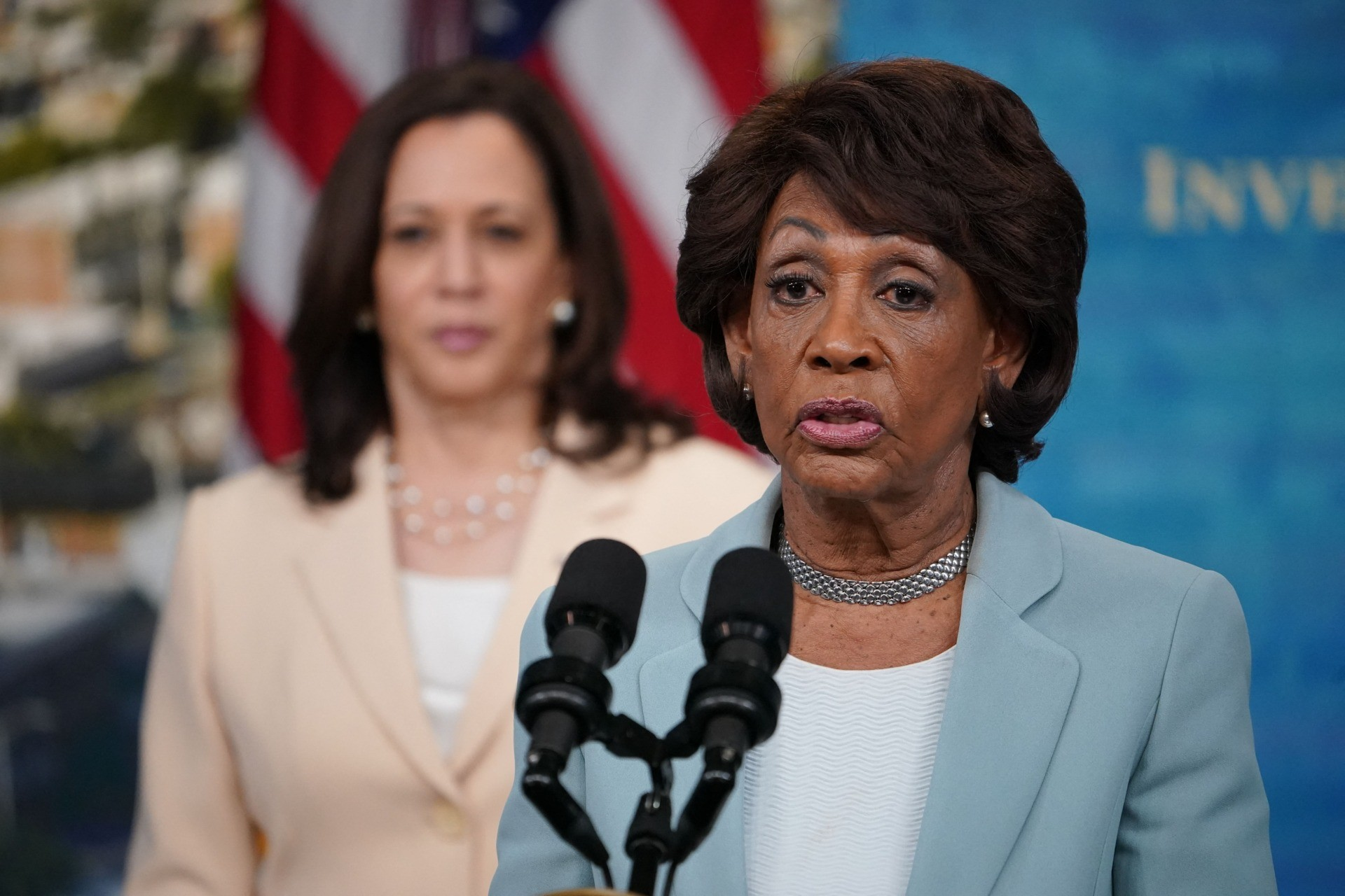 US Representative Maxine Waters,with Vice President Kamala Harris, speaks during the announcement for the disbursement of nearly $1.25 billion for Community Development Financial Institutions (CDFIs) in the South Court Auditorium of the Eisenhower Executive Office Building, next to the White House, in Washington, DC on June 15, 2021. (Photo by MANDEL NGAN / AFP) (Photo by MANDEL NGAN/AFP via Getty Images)