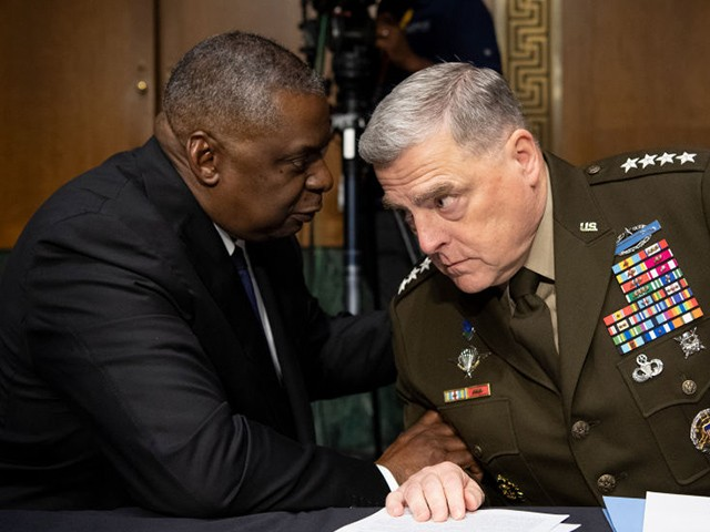 """WASHINGTON, DC - JUNE 17: Secretary of Defense Lloyd Austin, left, and Chairman of the Joint Chiefs of Staff Gen. Mark Milley talk before the start of the Senate Appropriations Committee hearing on """"A Review of the FY2022 Department of Defense Budget Request' on June 17, 2021 in Washington, DC. The hearings are to examine proposed budget estimates and justification for fiscal year 2022 for the Department of Defense. (Photo by Caroline Brehman-Pool/Getty Images)"""
