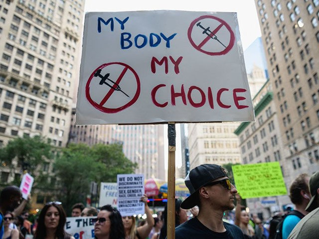 Protestors opposed to coronavirus vaccine mandates and vaccine passports by the government rally at City Hall in New York City on August 25, 2021. (Angela Weiss/AFP via Getty Images)