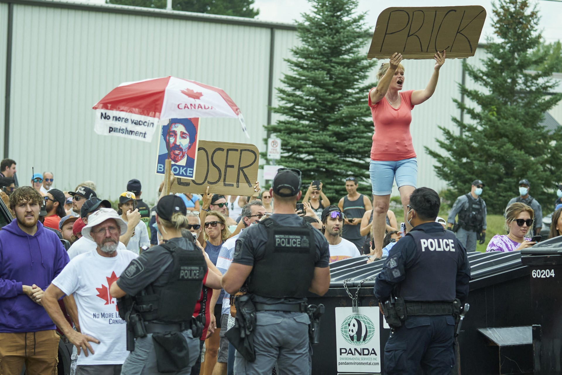 Protestors heckle Prime Minister Justin Trudeau during a Liberal campaign event at VeriForm Inc. in Cambridge, Ontario, on August 29, 2021. - Canadian Prime Minister Justin Trudeau's Liberal Party appears to be ceding popularity to its Conservative rivals, according to polls published August 28, 2021, with early elections only weeks away. (Photo by Geoff Robins / AFP) (Photo by GEOFF ROBINS/AFP via Getty Images)
