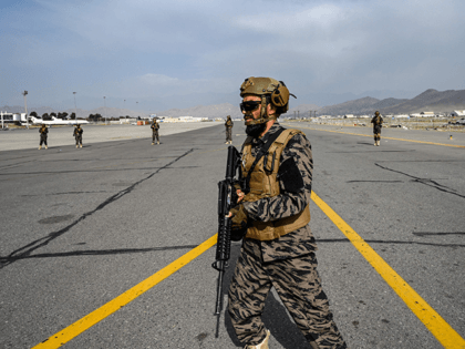 Members of the Taliban Badri 313 military unit walks at the tarmac as they secure the airport premises in Kabul on August 31, 2021 after the US has pulled all its troops out of the country to end a brutal 20-year war -- one that started and ended with the …