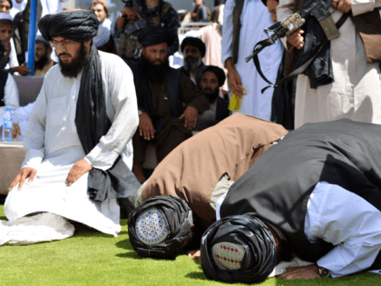 Taliban supporters pray during a gathering to celebrate the US withdrawal of all its troops out of Afghanistan, in Kandahar on September 1, 2021 following the Talibans military takeover of the country. (Photo by JAVED TANVEER / AFP) (Photo by JAVED TANVEER/AFP via Getty Images)