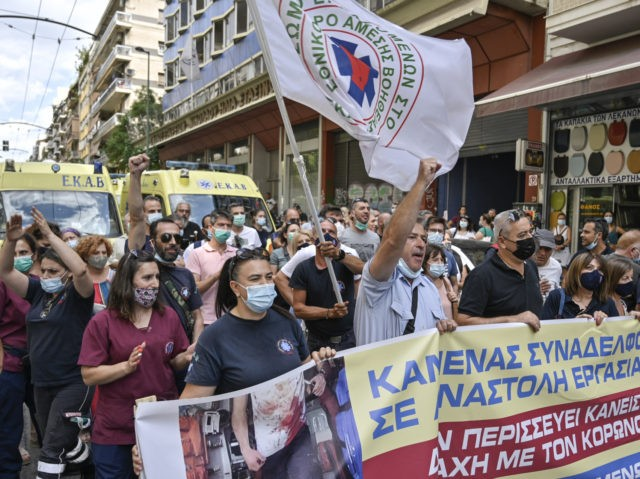 Health workers and ambulances staff protest with banners against mandatory Covid vaccines for health workers in central Athens on September 2, 2021. - Some 10,000 health workers in Greece faced being suspended as a deadline to get vaccinated against Covid-19 ran out, an union said. From September 1, inoculations become …