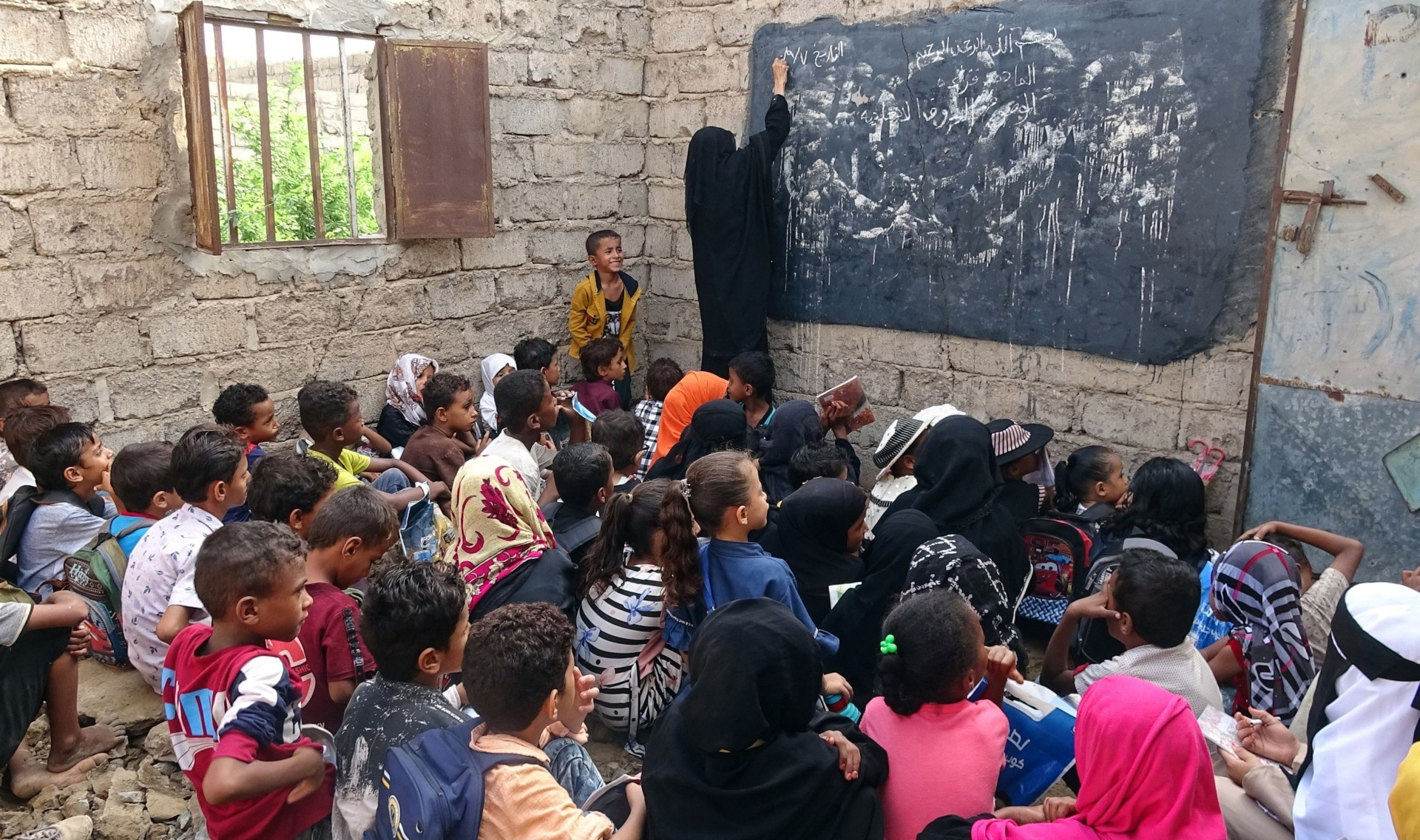 Displaced Yemeni children attend class in a dilapidated school building, in the war-torn western province of Hodeidah, on September 5, 2021. - Many schools in Yemen have been destroyed in the conflict between the government and the Huthi rebels or turned into refugee camps or military facilities. About two million children were without school even before the virus hit, according to the United Nations, which has warned the number will likely rise. (Photo by Khaled Ziad / AFP) (Photo by KHALED ZIAD/AFP via Getty Images)