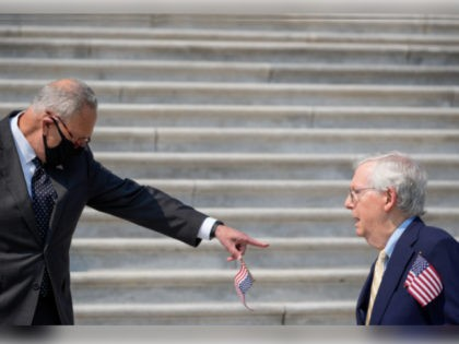 WASHINGTON, DC - SEPTEMBER 13: (L-R) Senate Majority Leader Chuck Schumer (D-NY) points at Senate Minority Leader Mitch McConnell as they arrive for a remembrance ceremony marking the 20th anniversary of the 9/11 terror attacks on the steps of the U.S. Capitol, on September 13, 2021 in Washington, DC. The …