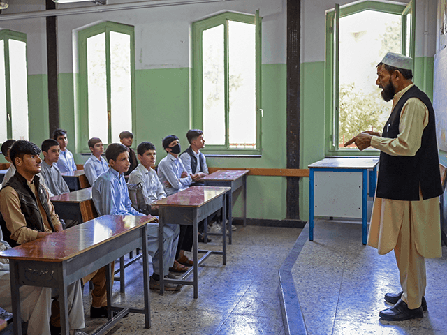Boys attend their class at Istiklal school in Kabul on September 18, 2021. (Photo by BULENT KILIC / AFP) (Photo by BULENT KILIC/AFP via Getty Images)