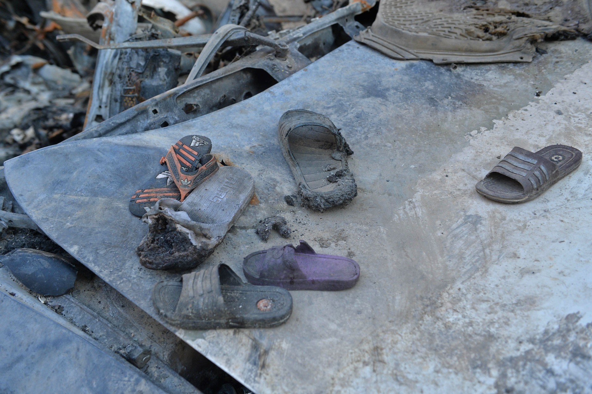 Partially burnt footwears are pictured amid the debris of the house of Ezmarai Ahmadi that was damaged in a US drone strike in the Kwaja Burga neighbourhood of Kabul on September 18, 2021. - Ezmarai Ahmadi was wrongly identified as an Islamic State militant by US intelligence, who tracked his white Toyota for eight hours on August 29 before targeting the car, killing seven children and three adults. (Photo by Hoshang Hashimi / AFP) (Photo by HOSHANG HASHIMI/AFP via Getty Images)