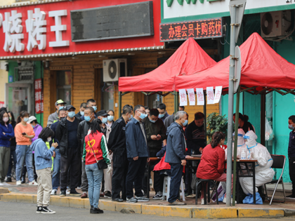 Residents queue to undergo nucleic acid tests for the Covid-19 coronavirus in Harbin, in China's northeastern Heilongjiang province on September 22, 2021. - China OUT (Photo by STR / AFP) / China OUT (Photo by STR/AFP via Getty Images)