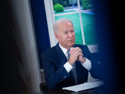 US President Joe Biden convenes a virtual Covid-19 Summit on the sidelines of the UN General Assembly, on September 22, 2021, in the South Court Auditorium of the White House in Washington, DC. - Biden urged leaders at summit to make sure 70 percent of their populations are covered by …