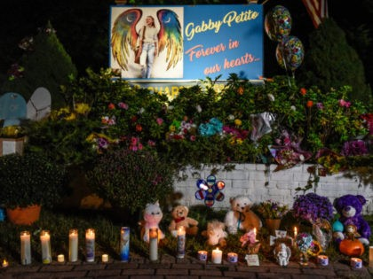 BLUE POINT, NY - SEPTEMBER 24: A sign at a roadside memorial honors the death of Gabby Petito on September 24, 2021 in Blue Point, New York. Gabby Petito's hometown of Blue Point put out candles along main streets and in driveways to honor the teenager who has riveted the …