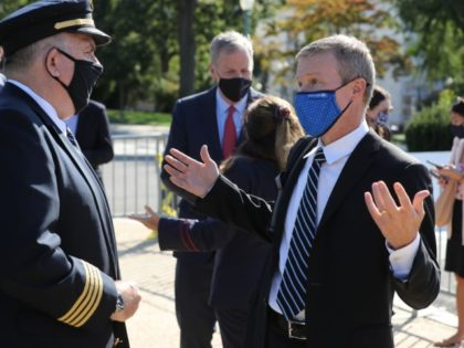 WASHINGTON, DC - SEPTEMBER 22: Wearing a face mask to reduce the risk posed by the coronavirus, United Airlines CEO Scott Kirby (R) talks with a pilot representative before a news conference to call on Congress to pass an extension of the Payroll Support Program to save thousands of travel …