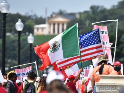 WASHINGTON, DC - JULY 23: Immigrant activists march on the Arlington Memorial Bridge Into DC demanding inclusion of citizenship in infrastructure package on July 23, 2021 in Washington, DC. (Photo by Shannon Finney/Getty Images for CASA)