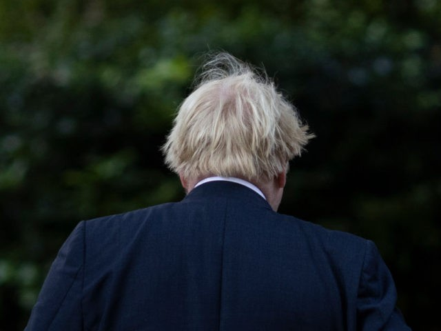 LONDON, ENGLAND - AUGUST 24: British Prime Minister Boris Johnson leaves Downing Street to host a virtual G7 meeting on Afghanistan at British Foreign and Commonwealth Office on August 24, 2021 in London, England. (Photo by Dan Kitwood/Getty Images)
