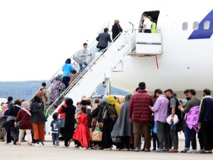RAMSTEIN-MIESENBACH, GERMANY - AUGUST 26: Evacuees board an Atlas aircraft bringing them from Afghanistan to the United States from the Ramstein Air Base on August 26, 2021 in Ramstein-Miesenbach, Germany. Ramstein has become one of the main preliminary destinations for evacuees leaving Afghanistan on U.S. military flights. U.S. forces there …