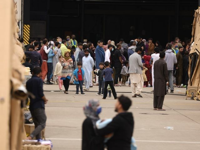 RAMSTEIN-MIESENBACH, GERMANY - AUGUST 26: Evacuees from Afghanistan are seen at a temporary emergency shelter at the Ramstein Air Base on August 26, 2021 in Ramstein-Miesenbach, Germany. Ramstein has become one of the main preliminary destinations for evacuees leaving Afghanistan on U.S. military flights. U.S. forces there have built a …