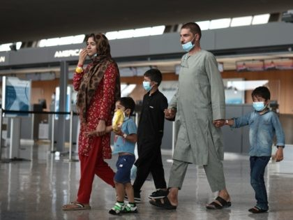 DULLES, VIRGINIA - AUGUST 31: Refugees are led through the departure terminal to a bus at Dulles International Airport after being evacuated from Kabul following the Taliban takeover of Afghanistan on August 31, 2021 in Dulles, Virginia. The Department of Defense announced yesterday that the U.S. military had completed its …