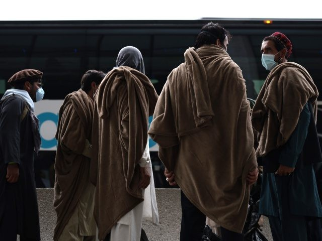 DULLES, VIRGINIA - AUGUST 31: Refugees board a bus at Dulles International Airport that will take them to a refugee processing center after being evacuated from Kabul following the Taliban takeover of Afghanistan on August 31, 2021 in Dulles, Virginia. The Department of Defense announced yesterday that the U.S. military …