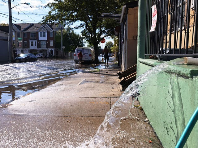 NEWARK, NEW JERSEY - SEPTEMBER 02: Water is pumped out of the basement of a home on Clifford Street on September 02, 2021 in Newark, New Jersey. Gov. Phil Murphy declared a state of emergency due to Tropical Storm Ida which caused flooding and power outages throughout New Jersey as …