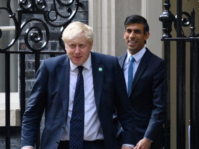 LONDON, ENGLAND - SEPTEMBER 07: Prime Minister Boris Johnson (L) and Chancellor of the Exchequer Rishi Sunak (C) walk towards the door of number 9, Downing Street ahead of a press conference on September 07, 2021 in London, England. Prime Minister Boris Johnson today announced a rise in national insurance …