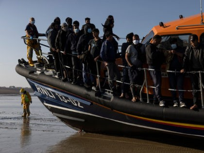 DUNGENESS, ENGLAND - SEPTEMBER 07: A group of migrants arrive via the RNLI (Royal National Lifeboat Institution) on Dungeness beach on September 7, 2021 in Dungeness, England. The week has seen a major increase in migrant numbers due to fair weather. (Photo by Dan Kitwood/Getty Images)