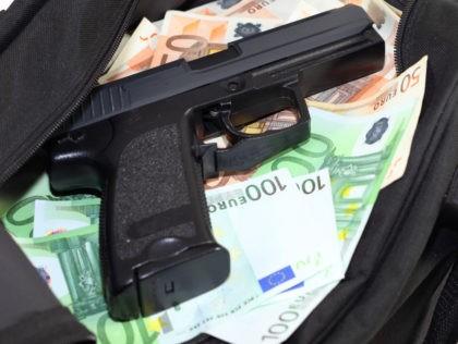 Sports bag full of money with gun-cutout